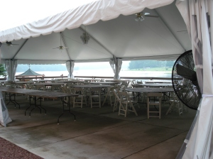 outdoor tented area setting up for an event