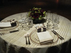 Party Rentals gold grid organza overlay and gold bead clear charger